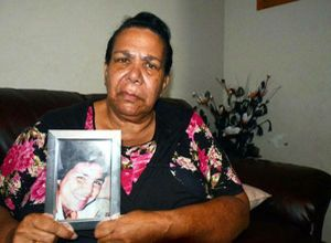 Colleen Walker's mother Murial Craig Walker holds a picture of her daughter.