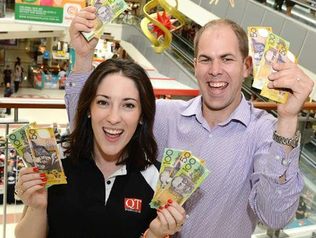 SPENDING UP BIG: Redbank Plaza centre manager Lee Anderson (right) and Lauren Roche from The Queensland Times plan to give away $10,000 in cash to lucky shopper.