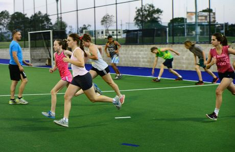 LET'S GO: Ipswich hockey players hoping to make Queensland under-15 or under-18 teams sweat it out during a training session with Steve Rogers at Raceview.