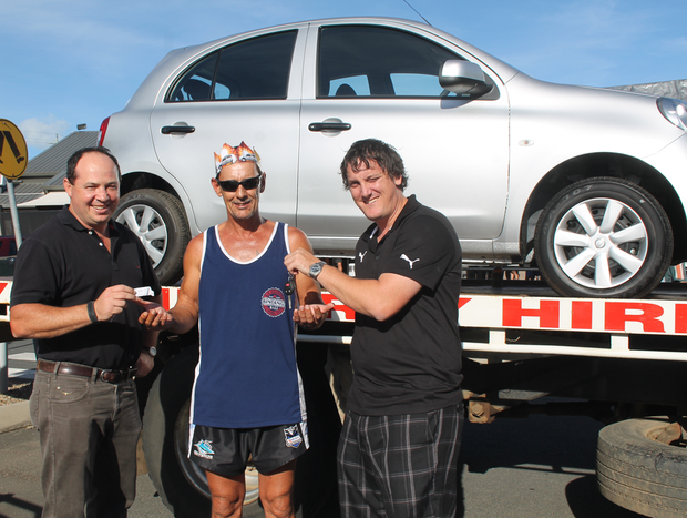 LUCKY DAY: Reef Gateway Hotel general manager Tony Barbara with the car giveaway winner Al Pannett and Rod Grittner's Nissan representative Wal Walton at the Reef Gateway on Sunday.