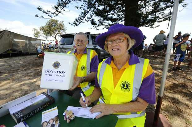 Alan Cunningham and Deyann McDonnell were selling raffle tickets for the Maclean Lions Club at the Brooms Head Family Fun Day on New Years Day. Photo JoJo Newby / The Daily Examiner