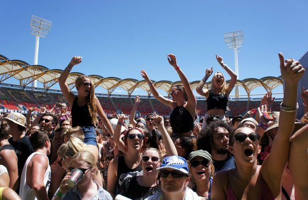 Fans dance to The Naked & Famous's set in Metricon Stadium at the Gold Coast Big Day Out.