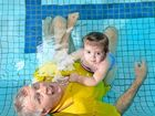 Laurie Lawrence and his grandaughter Harper Reid in the pool at his Banora swim school.