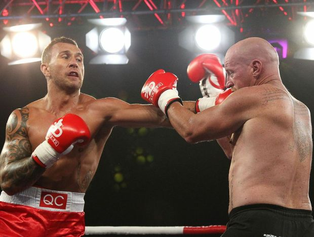 Australian rugby union player Quade Cooper (L) and Warren Tresidder during their cruiserweight fight in Brisbane, Wednesday, Jan. 29, 2014.