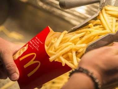 Fries being prepared at a McDonalds restaurant.