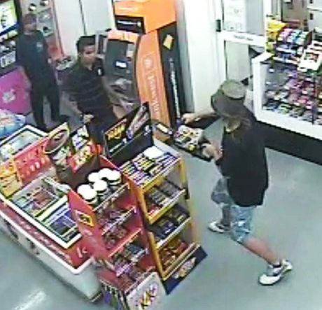 TERRIFYING SCENE: CCTV footage of a man holding a chainsaw inside the Flinders View petrol station.