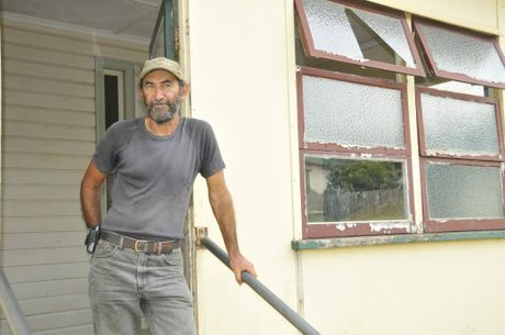 Joe Courte stands outside his rental property.