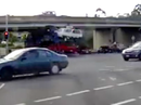 Truck carrying cars hits overpass