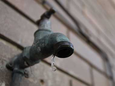 Dripping Tap: Fears water rates will soar in the coming years. Photo: Griffith Thomas / The Satellite IS160911WATER