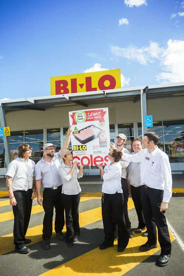 IT'S A SIGN: Jayden Austin, Tim Davis, Nicole Eaton, Michelle Beddall, Dean Austin, Samuel Eggins and Phil Gabanski push up the new Coles signage at the old Bi-Lo in South Grafton. Photo: Adam Hourigan/The Daily Examiner