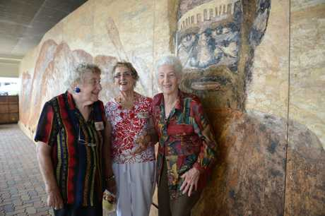 FOR SALE: Barbara Parker, Joyce Pole and Kay O'Grady (centre) with the 2.7m by 12.1m mural.