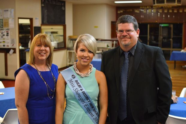 Image for sale: STEPPING OUT: The Dalby and District Show Society's 2014 Miss Showgirl, Stephanie Behrens, is all smiles as she celebrates with parents Suzanne and Russell at Dalby Golf Club on Saturday night. Photo Lyndon Keane / Dalby Herald