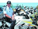 QUEENSLAND'S top cop stepped out from behind his desk yesterday to man a speed gun as part of Road Safety Week.
