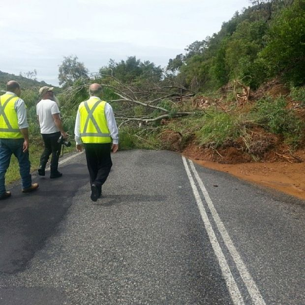 Keppel MP Bruce Young and Livingstone Mayor Bill Ludwig with The Bulletin photographer Allan Reinikka at the landslide at Statue Bay on the Scenic Hwy.