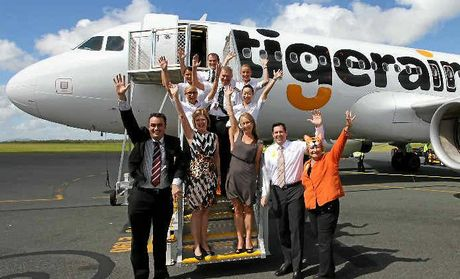 ROARING SUCCESS: Whitsunday MP Jason Costigan, Whitsunday mayor Jennifer Whitney, Tigerair cabin crew Jessica Kerney, Nynia Sebastian, Captain Peter Larsen, First Officer Julian Dauncey, cabin crew Jacqueline Weir and Yoshie Swale, Tigerair Australia head of communications Vanessa Regan, Whitsunday Regional Council CEO Scott Waters and Cr Jan Clifford, celebrating the inaugural Tigerair flight from Sydney to the Whitsunday Coast Airport on Tuesday.