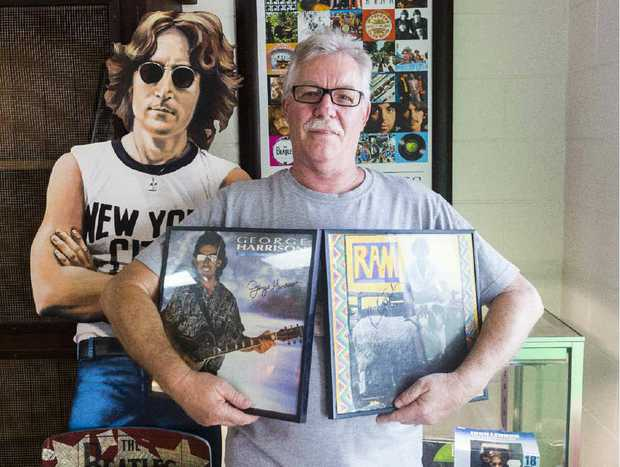 ORDER OF DAY: Alan Bray of Skinner St Takeaway with part of his extensive Beatles collection.