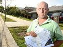 A MAN fed up with repeated fines for parking on the footpath in front of his own home has taken his fight to the Ipswich City Council.