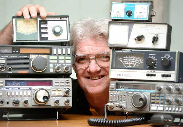 RADIO STAR: President of the Ipswich and District Radio Club Glen Woodrow shows off some of the club's old radios.