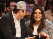 MILA Kunis and Ashton have sparked rumours they've gotten married after she was spotted wearing a new platinum band alongside her engagement ring.