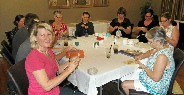 CHEERS: Lee Mackenzie and the pub knitters, who meet at The Ulster Hotel every fortnight.