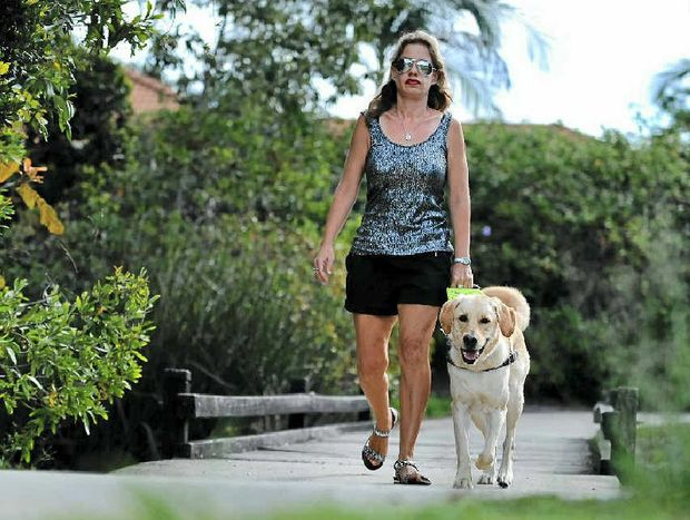 GUIDING HAND: Nicole Damarra of Sippy Downs, with her guide dog Hughie, is supporting International Guide Dog Day on Wednesday.