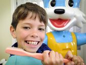 MOST eight-year-olds can't wait to get out of the dentist's chair - but Nikolai Bradley can't wait to come back to Toothbrush Land.