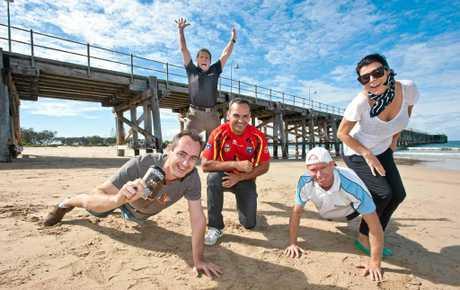 ON TRACK: Anthony Donovan (kneeling) joins supporters Luke Floyd, Rob H