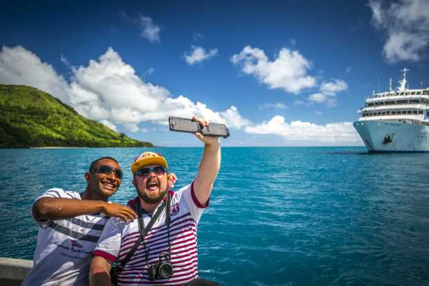 First-time traveller Griffith Thomas enjoying another one of life's first by taking a selfie with Captain Cook Cruises crewman Patrick while visiting Vuaqava Island.