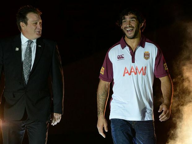 Queensland player Johnathan Thurston (right) and Ruigby League Great Alan Mills walk in during the Queensland Origin team announcement at Suncorp Stadium in Brisbane, Monday, May 19, 2014.
