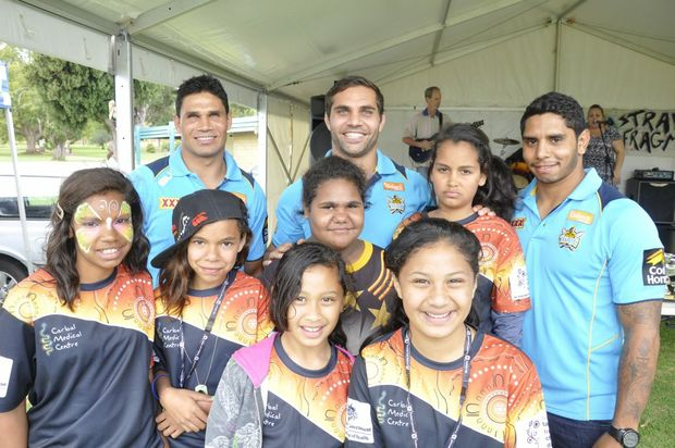 Gold Coast Titans players (from left) Brad Tighe, Maurice Blair and Albert Kelly enjoy the Carbal Family Fun Day with (from left) Rayleigh Colliss, Crystal Weatherall, Tayla Comer, Caitlin Lingwoodock, Liryc Comer and Alisha Wight.