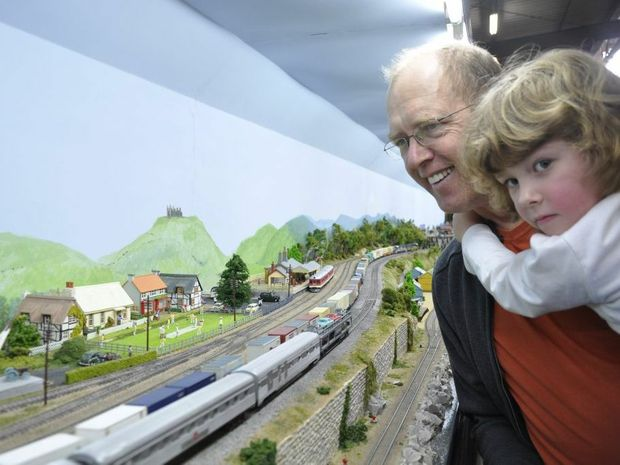 tim moorman and his daughter sarah marvel at the display