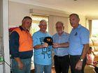 HELPING HAND: Hanson driver Brian Smith, Mark Wilson, Wayne Forno and TWU NSW Branch president George Clarke.
