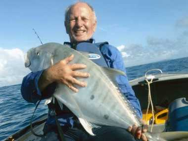 Fisherman John Ryan celebrates catching a golden trevally at the town of 1770 in April this year. Mr Ryan tragically drowned at Cooby Dam on Wednesday.