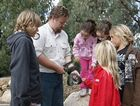 Wildlife Ranger introducing some children to a snake