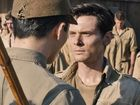 JACK O'Connell plays war veteran Louis Zamperini in the film, which premiered last night in Sydney. Jolie directs the film, based on Zamperini's biography.