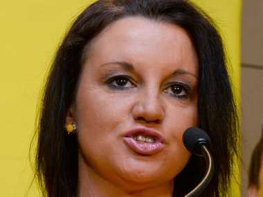 "A file photo taken on October 10, 2013 shows Australian Senator Jacqui Lambie of the Palmer United Party (PUP) speaking during a press conference in Sydney. Lambie, who told breakfast radio she would only date men who were rich and ""well-hung"", apologised on July 22, 2014, saying she had tried to hide her embarrassment with a joke."