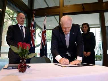 Queensland Premier Campbell Newman (left), watches the Consul for the Netherlands in Brisbane Captain Kasper Kuiper as he signs a condolence book for the victims of Malaysian MH17 in Brisbane, Tuesday, July 22, 2014. Up to 39 Australian citizens and residents have died in the MH17 air disaster over Ukraine.