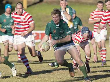 John Anderson for Condamine searches for a gap in the Toowoomba Rangers defence at Gold Park last Saturday.