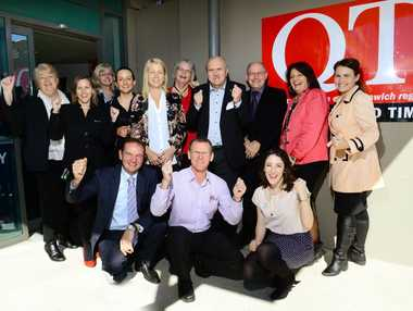 SIGNED ON: The QT and Ipswich businesses cheer on the City Pride campaign.