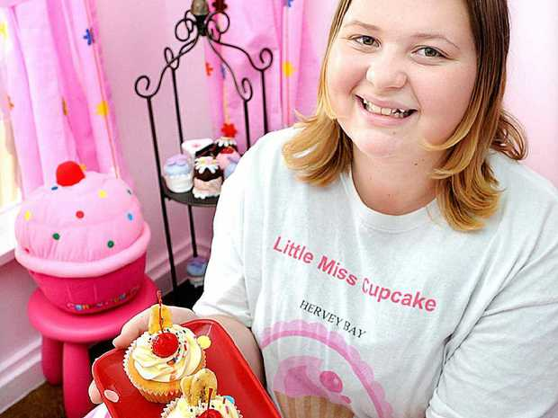 Hannah Miller, 14, presents goodies in the party room at Little Miss Cupcake, Hervey Bay.