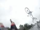 Cyclist lands on feet after car crash