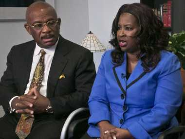 Attorney Willie Gary, left, listens as Cynthia Robinson speaks during an interview, Monday, July 21, 2014 in New York. Gary represented Robinson in a lawsuit against R.J. Reynolds Tobacco Co. The No. 2 U.S. cigarette maker is vowing to fight a jury verdict of $23.6 billion in punitive damages Gary won for Robinson on behalf of her late husband, Michael Johnson Sr., who died of lung cancer.