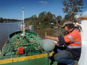 Boilermaker Peter Berthelsen works on the H.T. Amorena, a bunker barge, at the Maryborough slipway.