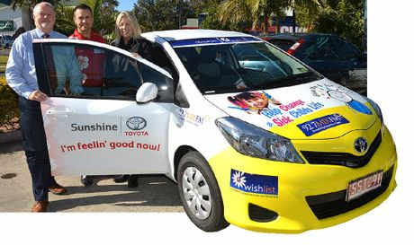 NEWLY MOBILE: Wishlist CEO Lisa Rowe takes delivery of three Toyota Yaris vehicles from John Williams of Mix FM and Darren Venning of Sunshine Toyota.