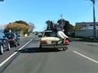 "VIDEO footage of what appears to be a man ""car surfing"" off the back of a moving car is being slammed by road safety authorities as ""incredibly dangerous""."
