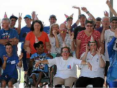 CELEBRATION: Sailability clients and volunteers celebrated securing their new shed on Tuesday. Pictured are Tony Chatwin, Jen Stratford, Jardi Bauer, John Skaller, Ashley Kennedy, Donny Hines, Jeremy Lammens, Brent Warcom, Alex Brown, Terry Murray, Tyler Smith, Peter Hudson, Kathy Baldwin, Wayne Lowth, Jenny Atkinson, Deb Staples, Adrian Pelt, Reudy Churio, Tracey Dignan, Scott Millar, Peter Wilhelm, Jim Tzatzalos, Serena Amandolia, Dewi Hughes, Bev Nelson, Ross Winterbourn and Cheryl O'Keeffe.