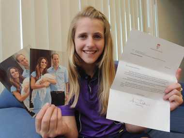 Ebony Reid with letter and postcards from the Duke and Duchess of Cambridge.