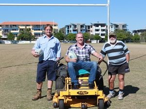 Council Parks Community Sports Field Officer, Jack Rea and Cr Jason OPray congratulating Maroochydore Rugby Union Club Groundsman, Basil Harris for being successful to receive funding