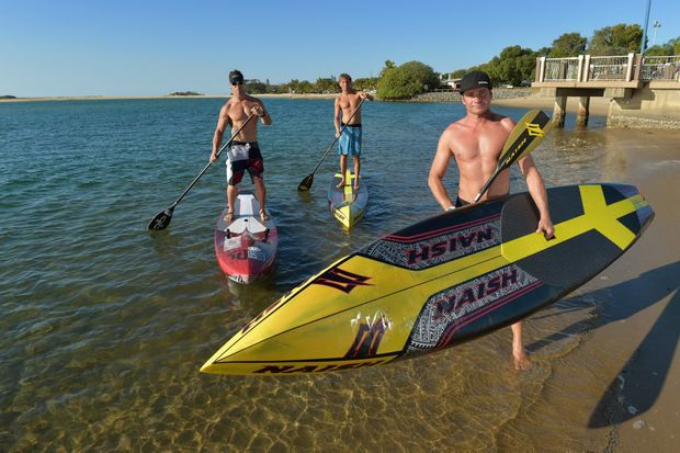 Stand-up paddleboarding continues to grow in popularity. Pictured are keen enthusiasts (L-R) Chad Islip, Brenden Clark and Luke King. Photo: Brett Wortman / Sunshine Coast Daily