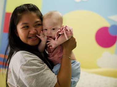 Thai surrogate mother Pattaramon Chanbua holds baby Gammy